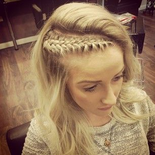 The side braid may be basic — so consider a slight twist by placing it on a diagonal and having a cool flip at your part. | 18 Ways To Get Perfect Festival Hair
