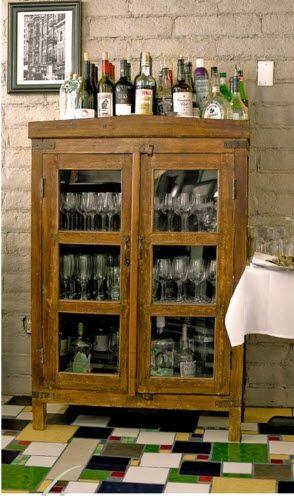Great vintage cabinet for a bar station.
