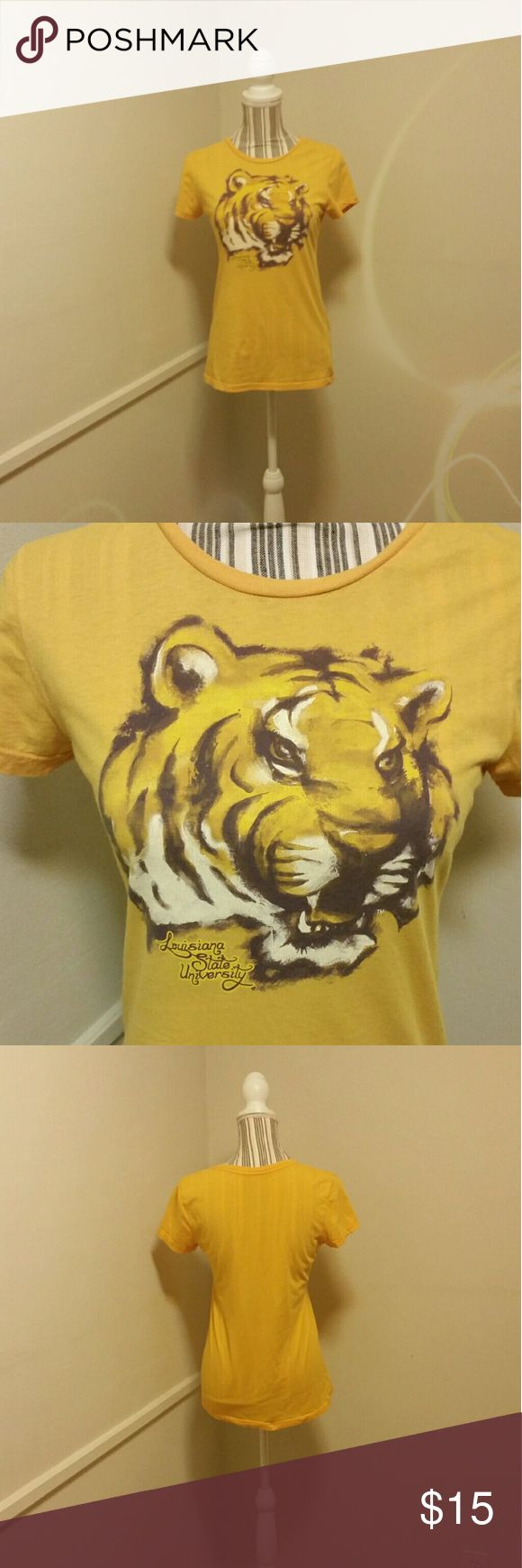 """LSU Tigers """"Mike the Tiger"""" Shirt Sz Large Pre-loved Women's LSU/Louisiana State University Tigers """" Mike the Tiger """" Short Sleeve Round Collar Tee Shirt in Size Large. Shirt is a Dark Yellow/Gold Color. Doesn't stretch but is true to size. Is in excellent condition.  Measurements : Length - 22 inches, Sleeve - 6 inches, Bust - 31 inches.  Geaux Tigers! Tops Tees - Short Sleeve"""