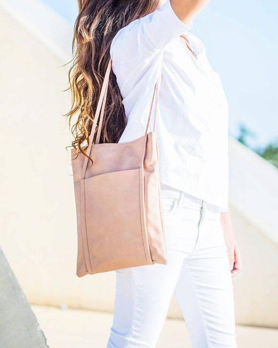 NETA bag is a leather tote bag, handmade in our studio from the beginning to the end.  Simple & Stylish  This bag is perfect as your everyday bag.