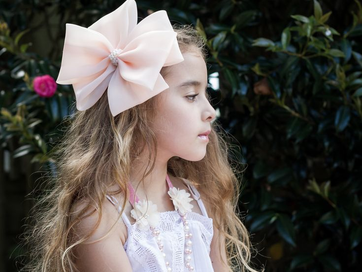 Our Majestic Duchess #Bow Hairclip in the softest Apricot organza, with an elaborate pearl and crystal bow centre.  Available online at www.siennalikestoparty.com