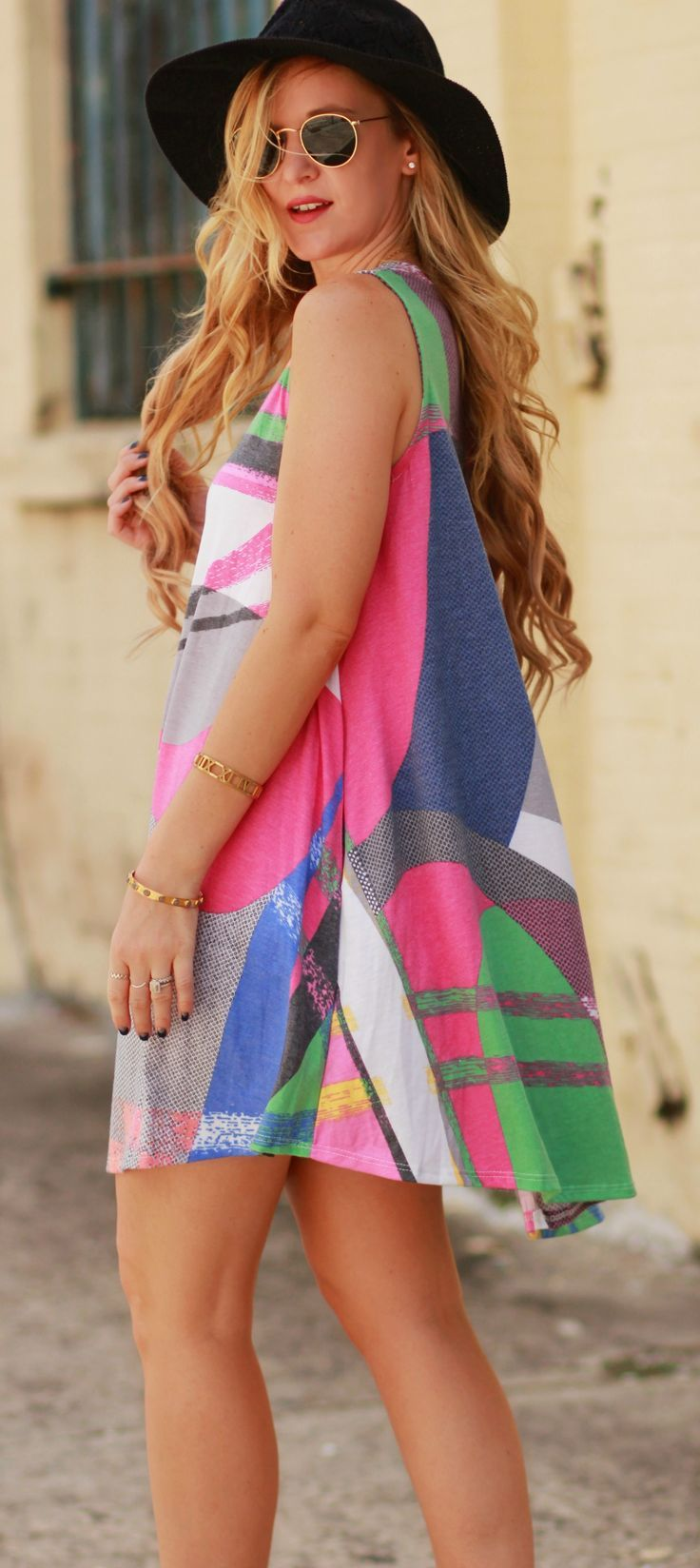 Colorful mosaic swing dress styled with Kendall and Kylie strappy sandals and round Ray Ban sunglasses for a cute summer outfit