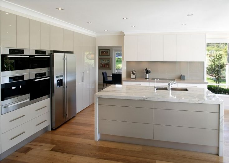 Inspiring Modern Kitchen Looks with Appealing Style Ideas: Kitchen With Cool Modern Ideas With Wooden Floor White Desk Minimalist Style ~ dropddesign.com Kitchen Inspiration