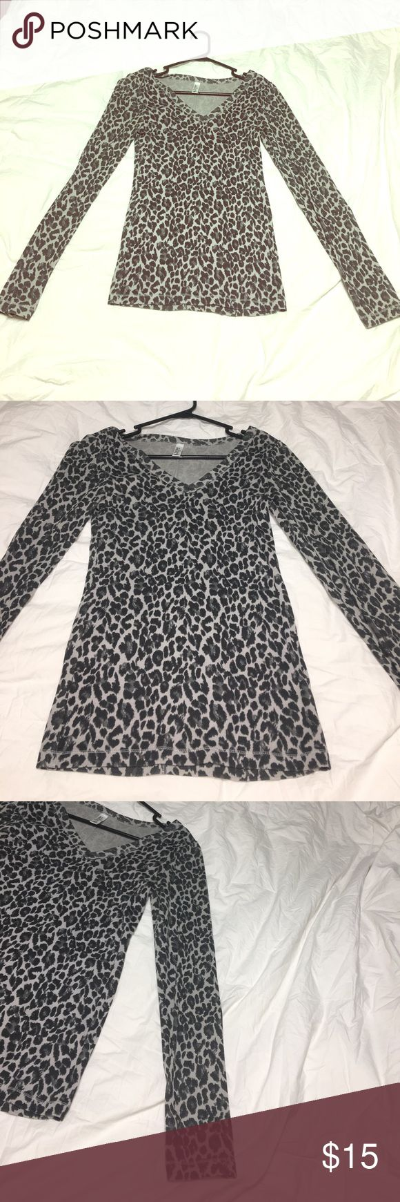 VICTORIAS SECRET - ANIMAL PRINT LONG SLEEVE TOP Bought this online from VS! You can dress it up or down! 60% Cotton 40% Polyester! Perfect condition! Victoria's Secret Tops