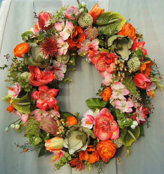 GLORIOUS STRIKING TROPICAL WREATH...This a large Showy Wreath....Sure to make a lasting Statement..!!! Over The Top !!! Includes: Pink Dedrobium Orchids, Green Magnolia Blossoms, Proteas, Amaryllis Flowers, Parrot Tulips, Green Anthurium, Bells of Ireland, Hot Pink Roses, Hypericum Berries, Allium, Orange Ranunculus, Hybiscus, Assorted Tropical Greenery This is a 28 x 26 Wreath....Very Full !! Greetings...Thank you for visiting my store !! I have been designing silk, dried, and fresh…