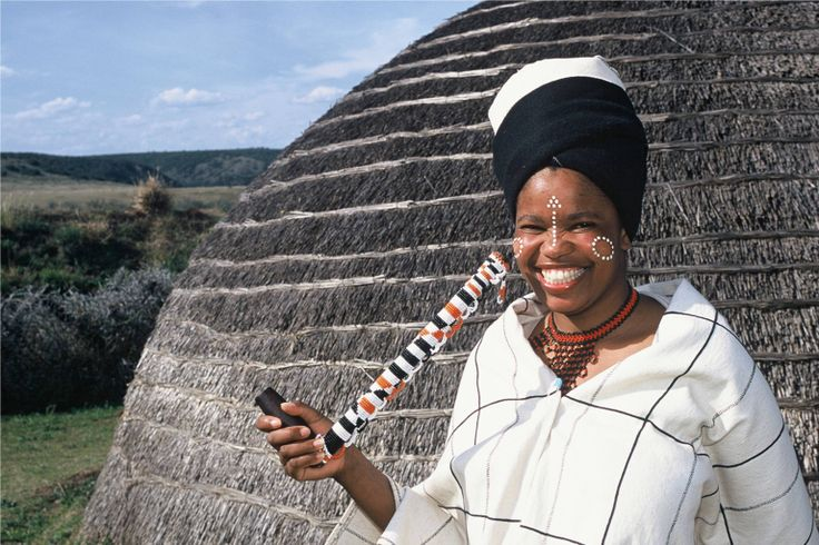 Africa | Xhosa woman standing in front of her hut.  South Africa | ©Nelson Mandela Bay Tourism