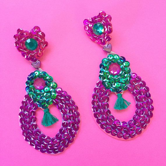 Hand Embroidered Earrings These stunning and incredibly sparkly purple, pink and green dangle earrings are made with surgical steel, hypo-allergenic studs. They are very light weight because of the materials used, being made with sequins that are hand sewn onto felt, with beads.