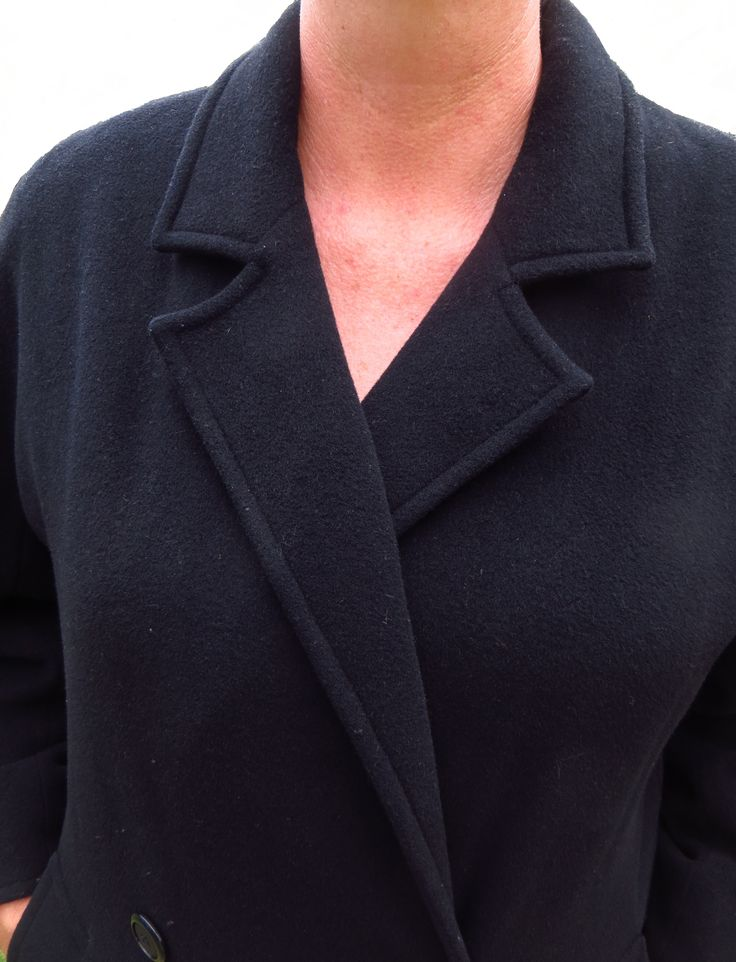 A straight cut cashmere and wool winter coat with a back flap, two pockets, double breasted,  very warm and soft and extremely comfortable. In stunning condition.