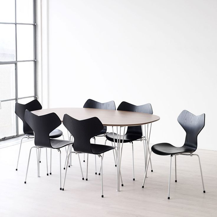 Super Super-Elliptical Table by Piet Hein, Bruno Mathsson, and Arne Jacobsen (1968) and Arne Jacobsen, 7 Chairs (1955)