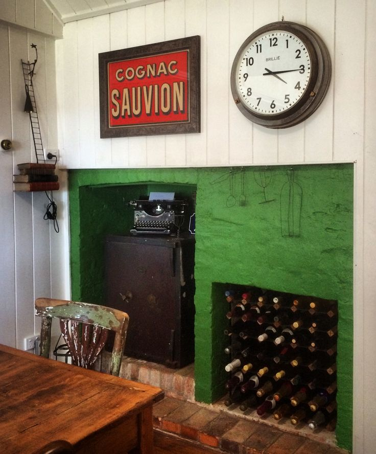 A splash of Dulux green on the old kitchen fireplace (rendered and previously painted beige) has given our dining room area a new life.