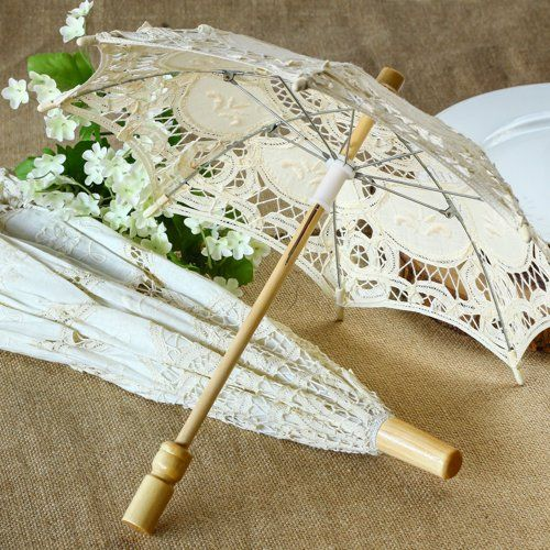 This antiqued Battenburg lace parasol is the perfect finishing touch for a romantic outdoor wedding.