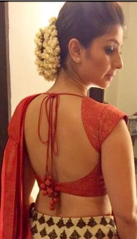 Tanisha in classic backless blouse.
