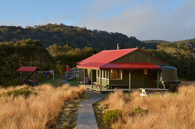Saxon Hut on the edge of Gouland Downs – one of seven Great Walk huts on the Heaphy Track, Golden Bay, New Zealand. Photo: Kathrin & Stefan Marks #dochuts