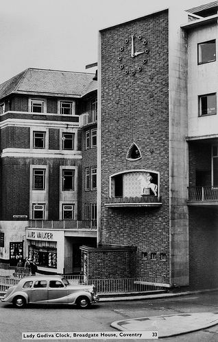 The clock in Broadgate .On the hour Lady Godiva would ride out with a figure of Peeping Tom looking out above.-1960s