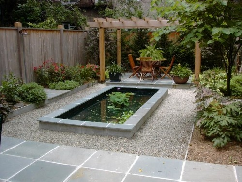 I have a very small raised fish pond in my backyard, but it doesn't look quite like this!