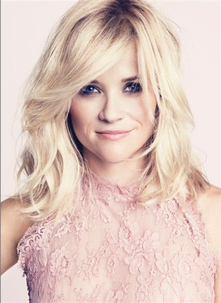 Reese Witherspoon, her hair...but brunette and a few inches longer...