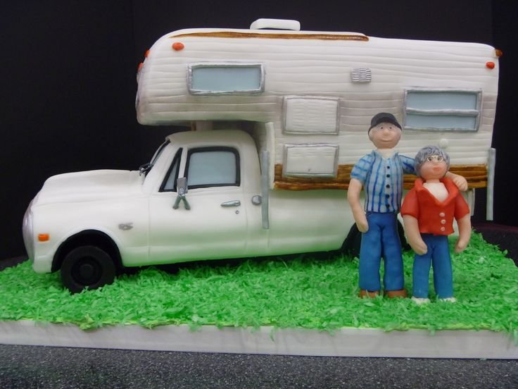 This is a cake I made for my parents 40th anniversary. This cake is special because they bought this truck and camper right after they got married and they still have it. Whenever anyone teases my dad about still owning them he always says Well, I still have the same wife too. That truck and camper really symbolize their marriage to me. The figures are made with modeling chocolate and the truck and camper is all cake. The grass is dyed coconut.