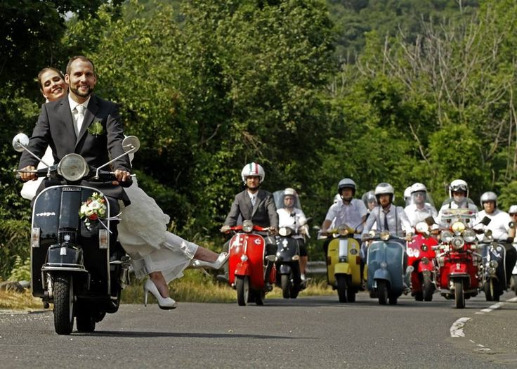 Vespa used as transportation in a wedding in Romania. Fantastic photo..