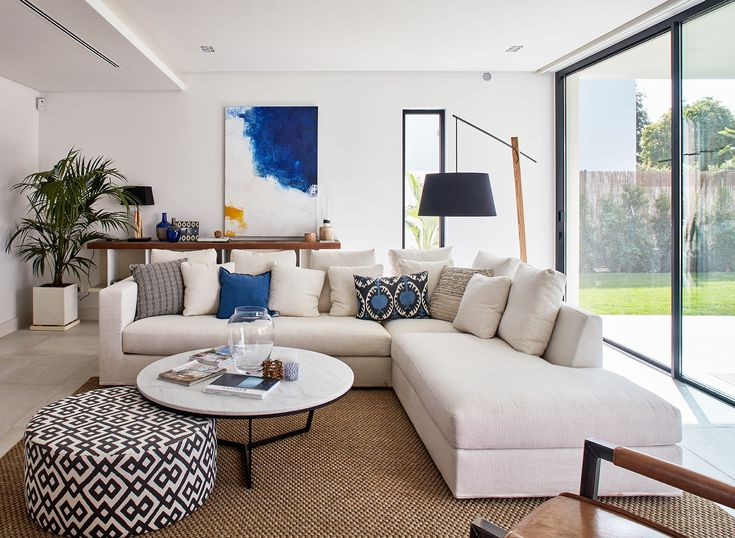 Living Room In Marbella Neutrals And Natural Materials With Indigo Blue Accents