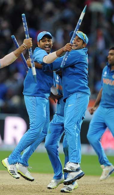 Rohit Sharma (L) and Suresh Raina celebrate #CT13 #Cricket