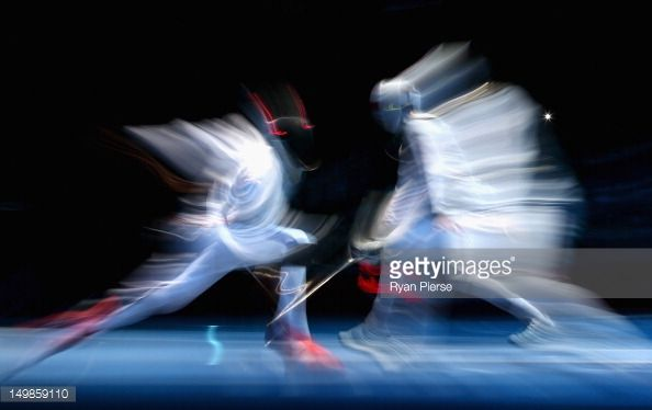 Enzo Lefort of France battles Laurence Halsted of Great Britain during the Men's Foil Team Fencing Classification 5-8 on Day 9 of the London 2012 Olympic Games at ExCeL on August 5, 2012 in London, England.