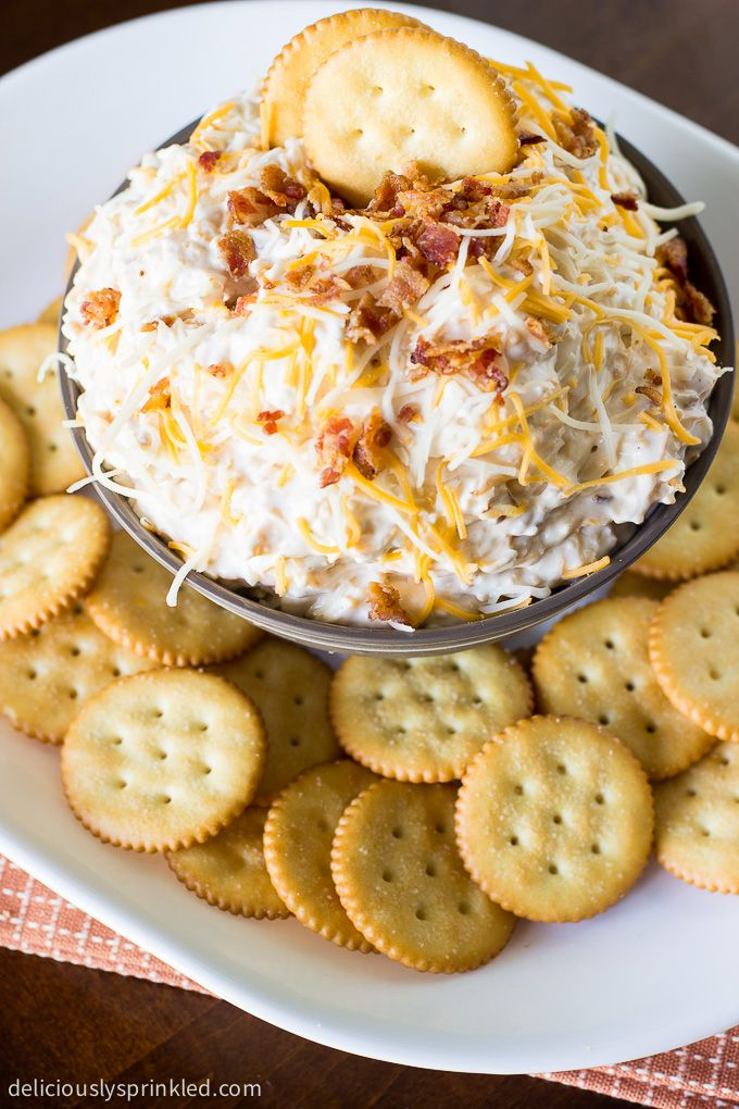 This Cheesy Bacon Ranch Dip is sure to be a hit at your next football game day party, it's loaded with cheese, bacon and beer. It's the ultimate party dip recipe!