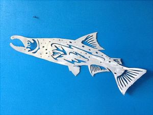 Steel or Aluminum Salmon Fish Sculpture Art. Spawning Chinook Salmon with Hooked Jaw. Aluminum: brushed aluminum .065 thickness, cut, shaped and finished. Steel: 14 gauge hot rolled steel with a 3 step patina finish.  The steel pieces can be sprayed with sealant to deter rusting outdoors. They do not come sealed.  Orders will be shipped within 2-3 weeks. Great in restaurants, coffee houses, game or recreation rooms, and bars worldwide. Large and very well packaged. NDILMW-Salmon