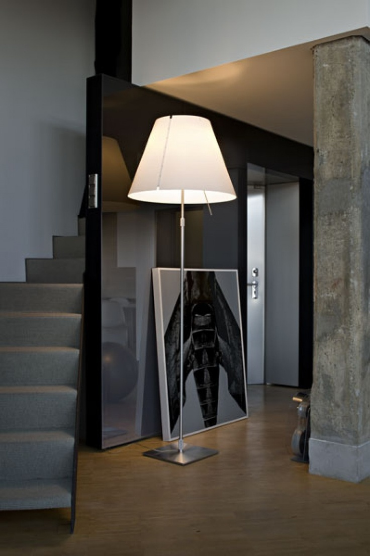 Floorlamp in the hall unusual but nice.  Paolo Rizzatto | Grande Costanza (by Luceplan)