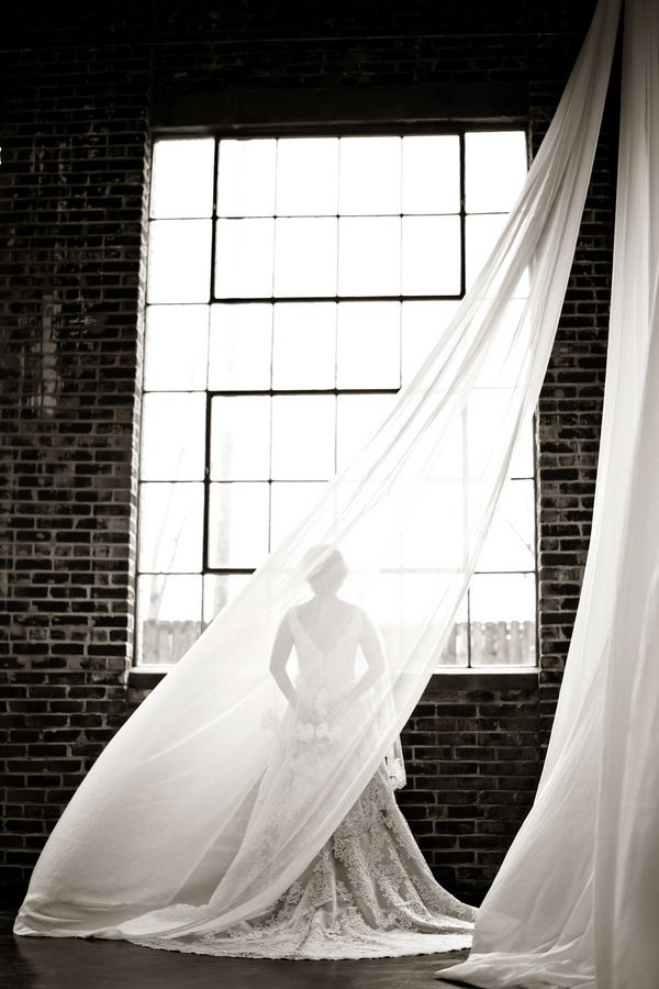 Black and white bridal portrait in front of tall window with curtain by Andie Freeman Photography | Two Bright Lights :: Blog