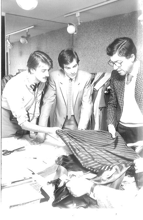 Nino Cerruti assessing fabric quality