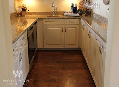 Woodmont Cabinets In: Florence Maple Antique With Cocoa Glaze Raised Panel