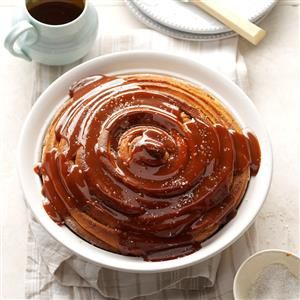 Giant Cinnamon Roll Recipe -This must-try cinnamon roll is all about the pillowy texture, the sweet spices and the homemade caramel drizzle. —Leah Rekau, Taste of Home food stylist