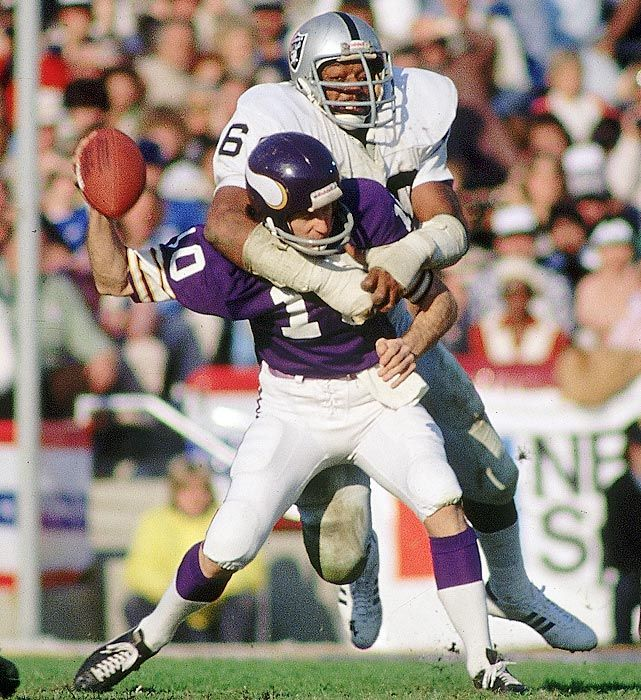 Raiders defensive end Otis Sistrunk sacks Fran Tarkenton, forcing the Vikings quarterback to fumble during Super Bowl XI in Jan. 1977. Oakland's offense had a field day with the Vikings, setting a Super Bowl record with 429 yards of offense in the 32-14 win. (Walter Iooss Jr./SI)  GALLERY: SI's 100 Best Super Bowl Photos