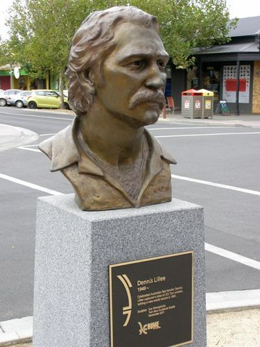 Dennis Lillee, Sunbury, Victoria, sculpted by Sue Alexopoulos, Tom Bass Sculpture Studio  November 2011.  Tom Bass AM (1916 – 2010) was a renowned Australian sculptor. Born in Lithgow, NSW he studied at the Dattilo Rubbo Art School and the National Art School. In 1988, he was made a Member of the Order of Australia (AM) for services to sculpture.