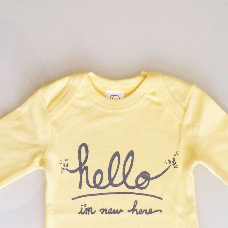 Hello I'm New Here - gender neutral modern baby gift - long sleeved romper (6-12m - butter/grey) by eggagogo on Etsy https://www.etsy.com/listing/216060643/hello-im-new-here-gender-neutral-modern