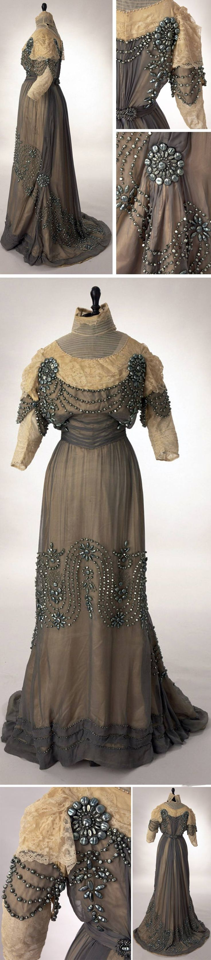 Reception gown, Mme. Renfrew Wood, New York, 1912. Gray silk chiffon over ivory China silk trimmed w/hand-painted metal shells made to look like freshwater pearls. Upper bodice & sleeves are ivory lace over cream silk. Stand collar down through throat is pleated silk tulle set with appliquéd lace. Satin-covered discs accent neckline between chiffon & tulle-- also at sleeve hem. Chiffon on bodice is pleated just above waistline to give cummerbund effect. Slight train. Via Woodland Farms…