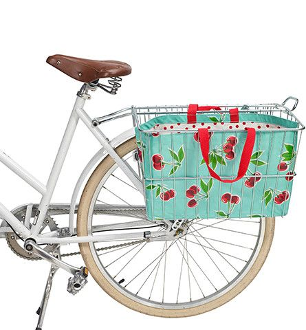This is our newest rear basket oilcloth tote. It is perfectly sized to fit your rear basket. Designed to be easily removed so you can carry you can take it with you - into a shop, farmers market etc,