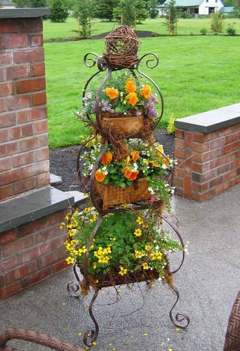 This gives me an idea to use a three tiered metal hanging basket stand meant for the kitchen that I saw recently as a planter. Might just try that!