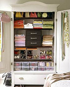 Organized armoire used as clothes storage