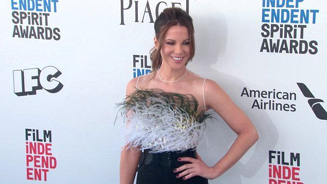 Kate Beckinsale gorgeous at Independent Spirit Awards. She wore a black dress with green and white frills on top over a sparkly bustier and held together with sheer fabric. She wore her hair in a high ponytail.