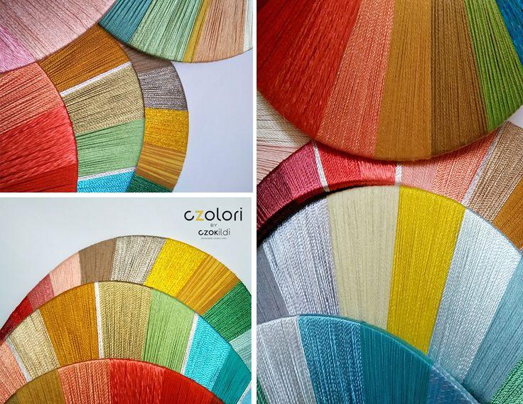 Rainbow of yarn, detail of yarn wrapped necklaces by Czolori http://czokildihu.bigcartel.com/category/geometric