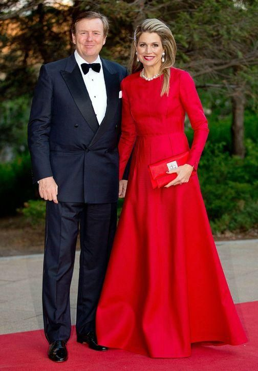 We love Queen Maxima's long-sleeve, bright red Valentino gown (click for more!)