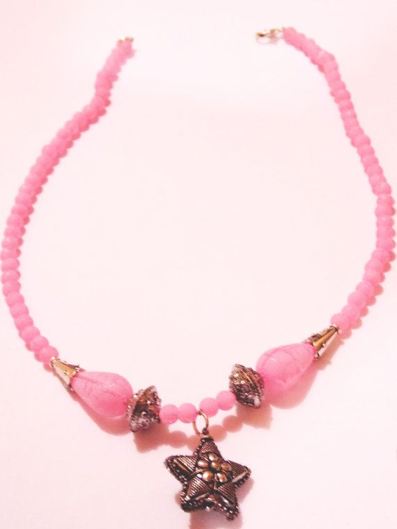 Pink neon beads necklace with carved star pendant. Also used steel coated plastic beads.