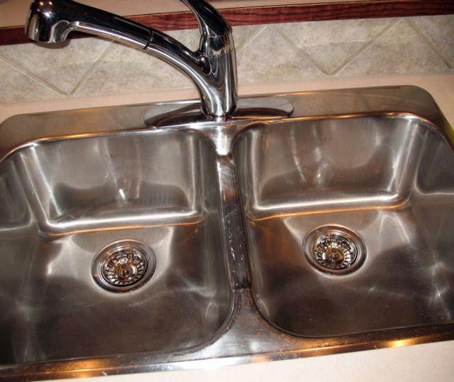 This is how I clean my stainless steel sink.  It's a quick task that makes my kitchen sparkle! | How to Clean and Shine Your Stainless Steel Sink | Simple Joys Of Home