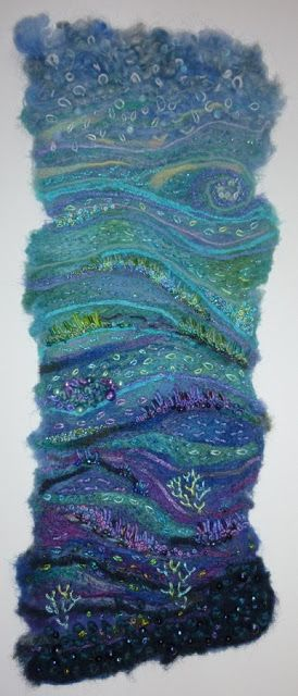 Seascape by Su Harris - Made by embellishing merino tops, silk bricks, ribbons and yarns onto a baby-wipe, then adding detail with hand embroidery and beads.