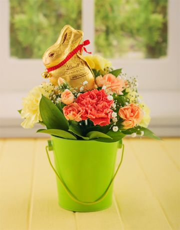 46 best easter eggs and gift hampers images on pinterest easter easter flowers bright easter carnations in a bucket negle Images