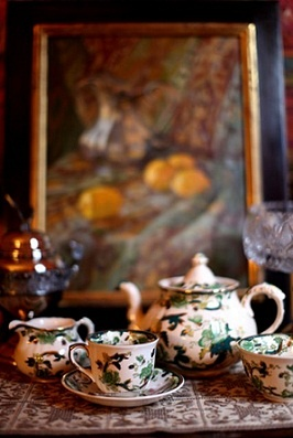 """The green and gold floral tea set was a gift from la Condesa's English grandmother. The pattern is Mason's Mandalay's Chartreuse. The painting behind it is by Austrian artist Maxine Bomer Foto by L. Lewin"" HRH The Duchess of State Blogspot"