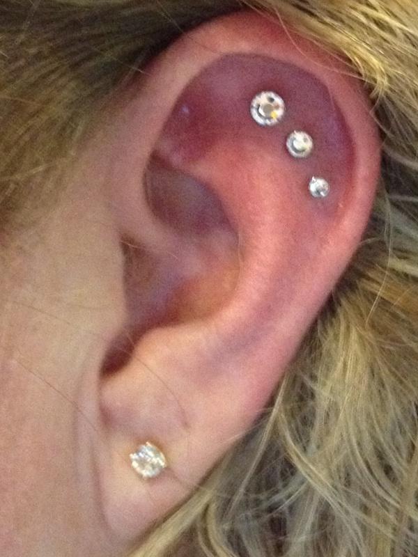 Trifecta of innner ear cartilage piercings.  Endless options