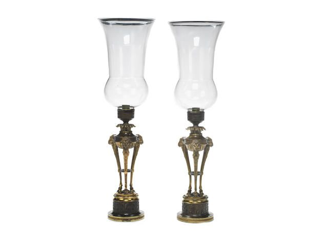 date unspecified A PAIR OF LATE GEORGE III GILT AND PATINATED BRONZE STORM LANTERNS WITH GLASS SHADES £ 2,500 - 3,500 US$ 3,500 - 4,900. unsold