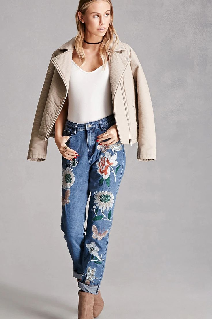 A pair of boyfriend jeans by Pixie & Diamond™ featuring floral embroidery on front, high-rise fit, cuffed ankles, a five-pocket construction, and a zip fly.